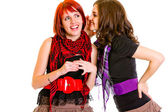 Girl whispering gossips in ear her interested girlfriend — Stock Photo