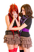 Attentive young girl calming her sad girlfriend — Stock Photo