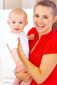 Portrait of happy baby and smiling mommy — Stock Photo