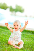 Happy baby playing on grass — Stock Photo