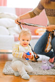 Lovely baby playing on floor — Стоковое фото