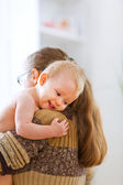Little cute baby hanging mama — Stock Photo