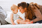 Young mother playing with her baby — Stock Photo