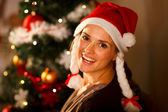 Portrait of beautiful woman near Christmas tree — Stock Photo