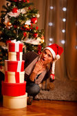 Surprised beautiful woman near Christmas tree — Stock Photo