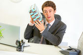 Interested businessman shaking present box trying to guess what' — Stock Photo