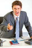 Angry modern businessman shouting and pointing on you — Stock Photo