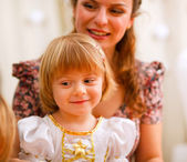 Portrait of mother and daughter looking on something — Stock Photo