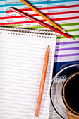 Coffee and notebook on desk — Stock Photo