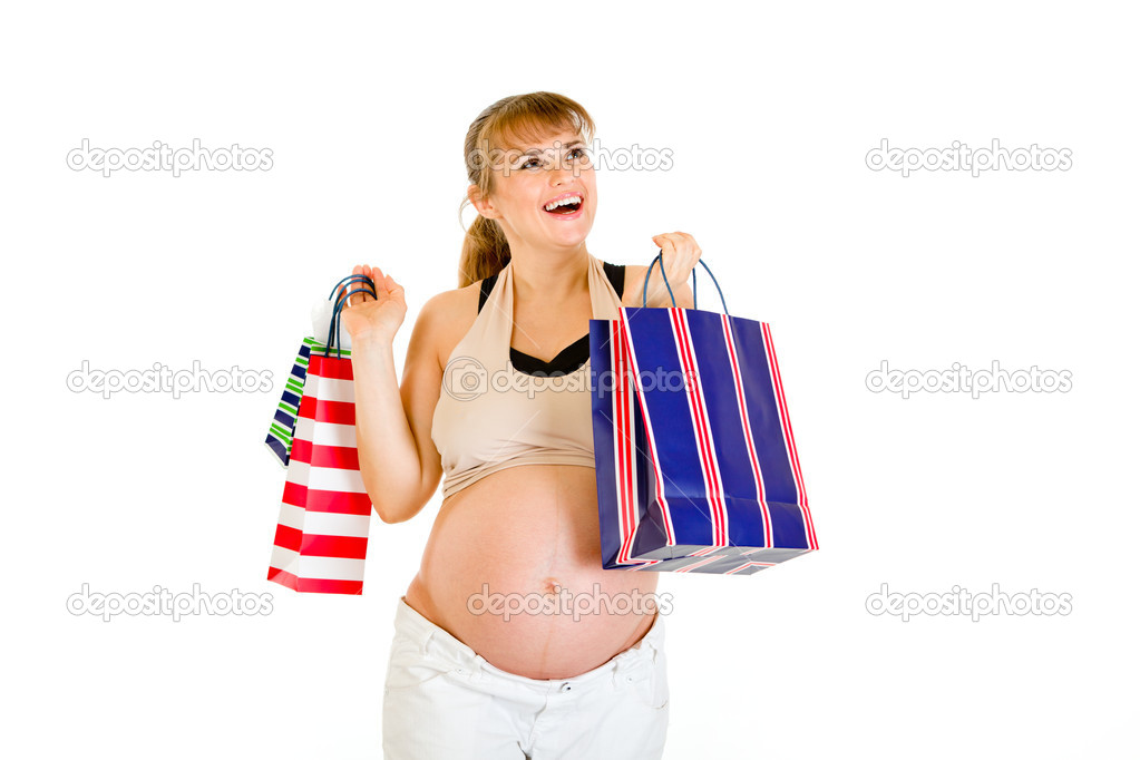 Happy pregnant woman holding shopping bags in hands isolated on white — Stock Photo #8655577