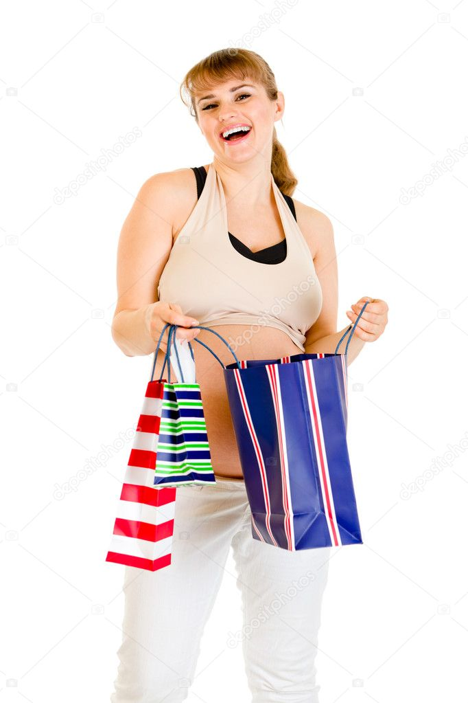 Happy pregnant woman holding shopping bags in hands isolated on white — Stock Photo #8655579