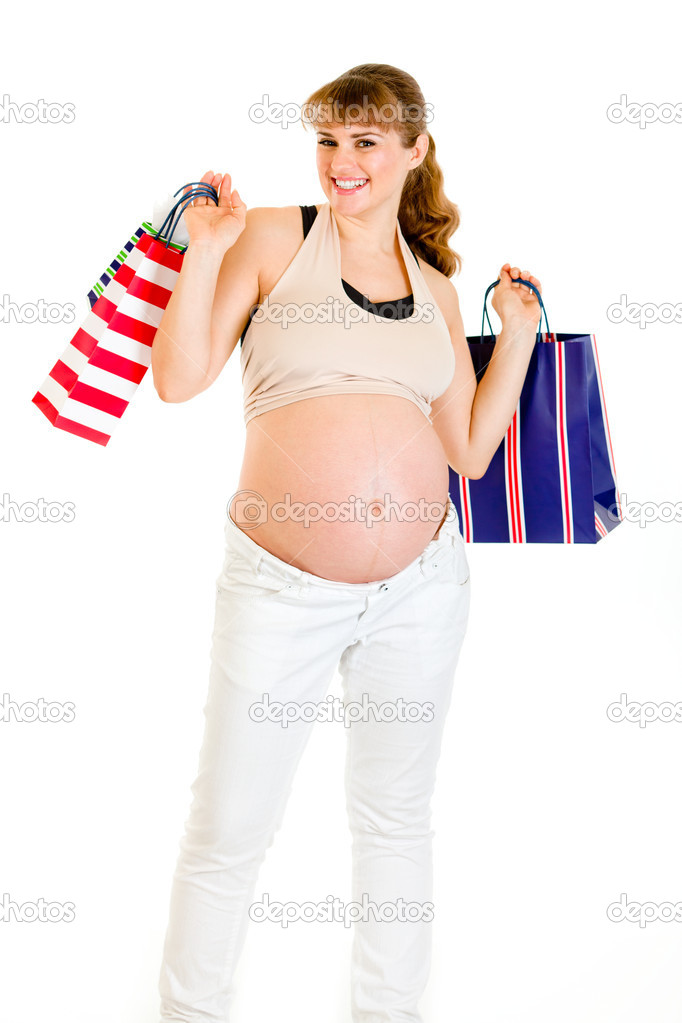 Happy pregnant female holding shopping bags in hands isolated on white — Stock Photo #8655581