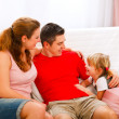 Mother father sitting on couch and talking with daughter — Foto de Stock