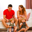 Twins daughters playing on console at home — Stock Photo #8996945