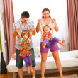 Mother and father having fun with twins daughters — Foto de Stock