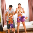 Mother and father having fun with twins daughters — Stockfoto