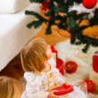 Two girls opening presents near Christmas tree — Stock Photo