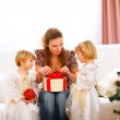 Mother opening gift presented by twins girl — Stock Photo #8996999
