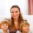 Portrait of mother with twins daughters — Stock Photo #8997000