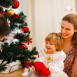 Family spending time near Christmas tree — Stock Photo