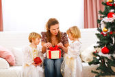 Mother opening gift presented by twins girl — Stock Photo