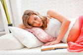 Pregnant woman fell asleep while reading book — Stock Photo