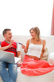 Happy pregnant woman with husband shopping on Internet — Foto Stock