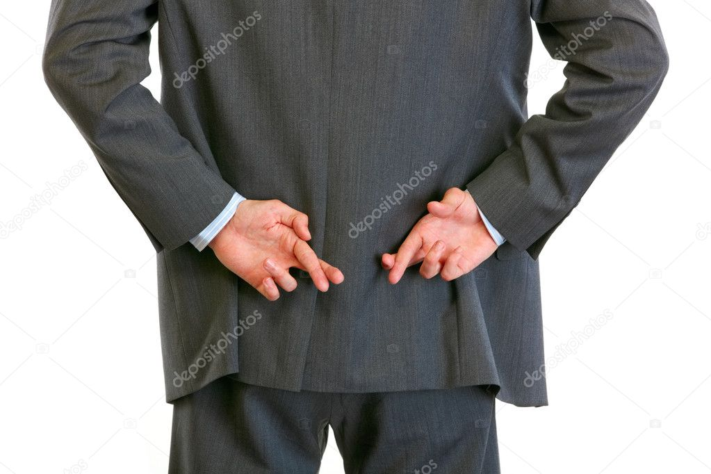 Closeup on hands with crossed fingers behind businessman back — Stock Photo #8999631