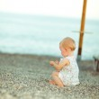 Lonely baby playing on beach — Stock Photo