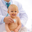 Baby being checked by pediatrician doctor using stethoscope — Stock Photo