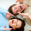 Young couple shouting through megaphone shaped hands — Stock Photo #9428050
