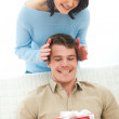Young woman making surprise to boyfriend — Stock Photo