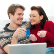 Young couple making online purchases — Stock Photo