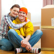 Portrait of moving to new house young couple among boxes — Stock Photo