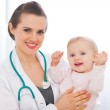 Portrait of pediatrician doctor with smiling baby — Stock Photo #9428751