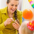Mother celebrating first birthday of her baby — Stock Photo