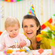 Portrait of mother and baby with birthday cake — Stock Photo #9428830