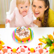 Portrait of happy mom and baby with birthday cake — Stock Photo