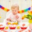 Stock Photo: Portrait of eat smeared baby eating birthday cake