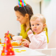 First birthday celebration party with mother and baby — Stock Photo #9428871