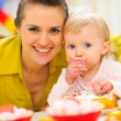 Happy mother and baby on first birthday celebration party — Stock Photo