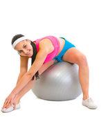Slim girl making exercises on fitness ball — Stock Photo