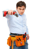 Construction worker pointing electric screwdriver as a gun in ca — Stock Photo