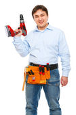 Smiling construction worker with electric screwdriver — Stock Photo