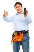 Construction worker pointing on mobile — Stock Photo