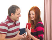 Happy young couple exchanging presents — Stock Photo