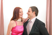 Portraits of formally dressed smiling couple — Foto de Stock