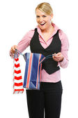 Surprised woman looking in shopping bag — Stok fotoğraf