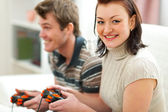 Young couple plying on console — Stock Photo