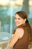 Portrait of beautiful young woman at terrace — Stock Photo